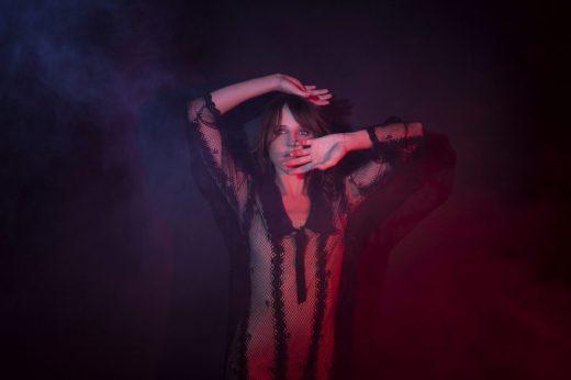 Katie Burden poses in her aura